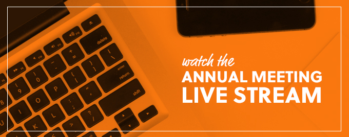 Annual Meeting Live Stream banner featuring overhead image of a computer keyboard